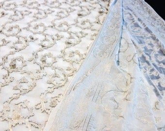 White Georgette Jacquard Fabric with Silver and Gold Floral Vine Pattern and Brocade Border
