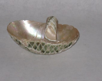 Small carved shell basket with handle