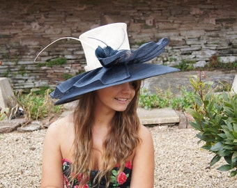 A beige straw crown , with navy sinamay double brim