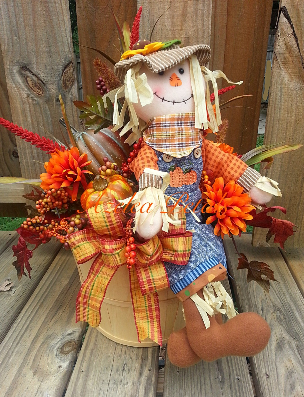 Fall scarecrow bushel basket with pumpkins arrangement