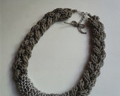 Handmade braided i-cord necklace. Gray bib necklace with silver chain in the center.