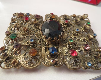 A Decorative be-jewelled belt buckle