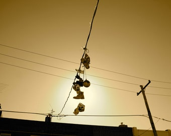 Sneakers Hanging on a Telephone Wire in Philadelphia Photo Print