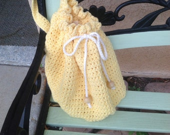 Over the shoulder crocheted yellow lined purse
