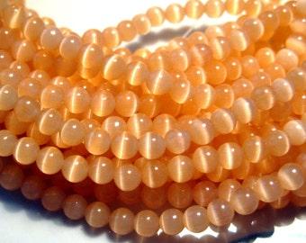 1 strand Light Orange Cat's Eye Glass Beads 4mm Round