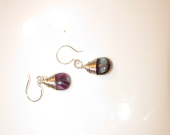 Wire wrapped smooth purple and green flourite briolettes on silver earwires.