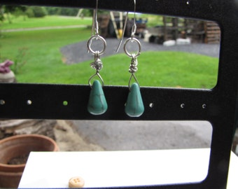 Silver wrapped tiny turquoise briolettes on silver earwires.