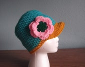 Bright colors beanie with flower and bill.