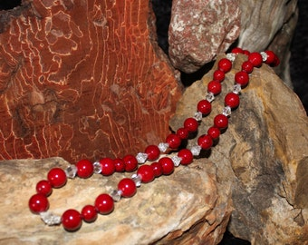 Hand beaded necklace made with red riverstone and clear crystal bead.