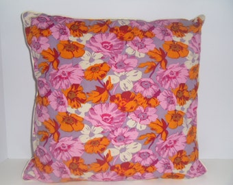 16 inch square 100% cotton floral pillow with piping trim.