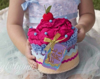 Alice in Wonderland oversized faux cake Eat Me cupcake party decor fairytale handmade party centrepiece
