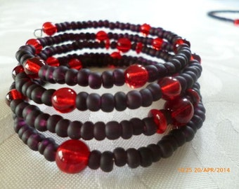 Dark Violet Bracelet on the memory wire, with red beads