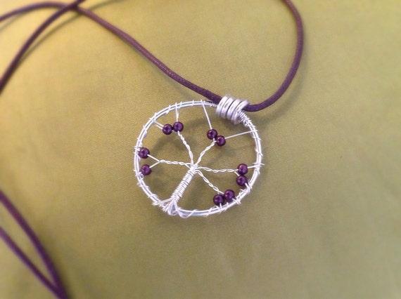 Tree of Life pendant on purple cord