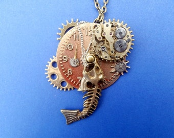 Unique Wearable Art Pendant Using Upcycled Watch Parts. One of a kind and handmade in the UK.