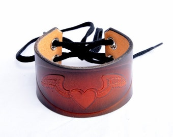 Leather Wrist Cuff. Winged Heart Ladies Leather Cuff. Hand Dyed Leather Wrist Cuff. Lace Up Leather Wrist Cuff made By Leather Meister.