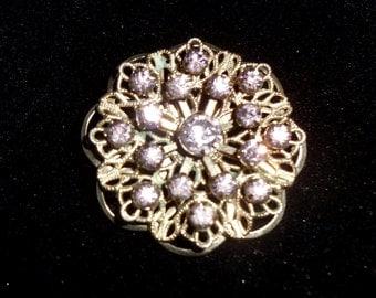 Vintage silver tone filigree pin / brooch with violet rhinestones