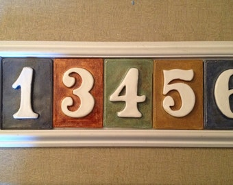 House number tile plaque. 5 number style. Pvc and  weatherproof with many color possibilities. Address plaque horiz. or vertical.