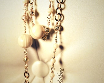 Gold beads necklace and cream