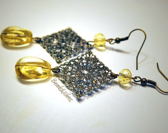Filigree earrings and yellow stone