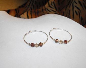 Silver hoop earrings with purple crystal rondelles