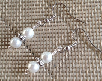 Earrings in antique silver with faux white pearls.