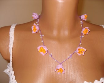 Necklace with pale purple bells
