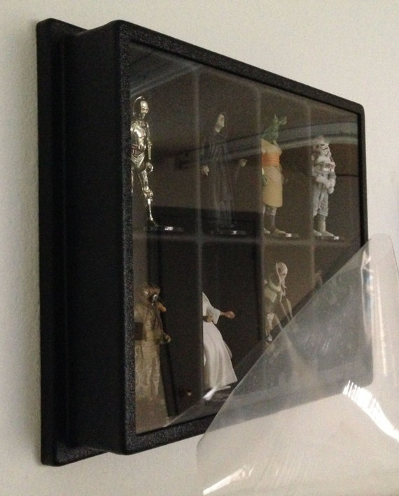 action figure display case with dust cover and wall mount star