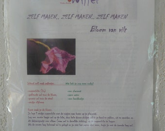 Zelfmaakpakketje a flower of felt. There are two color variants available nml. cyclamen/turqoise and Red/purple.,