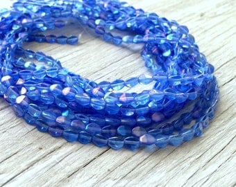 Glass beads, Czech glass pinch beads blue sapphire with luster coating 50