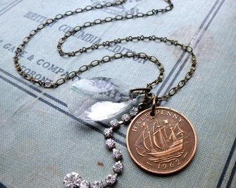 Lost & Found Charm Necklace. Repurposed Ship Coin. Reclaimed Chandelier Prism. Recycled Rhinestones. Long Antique Brass Chain.