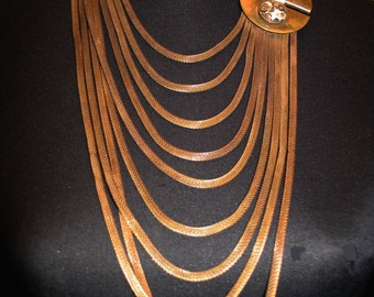 Hand Crafted Graduated Nine Strand Oxidized Brass Necklace with Leopard Jasper Cabochons