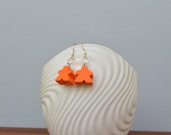 Orange mini Carcassonne meeple earrings with silver earwire