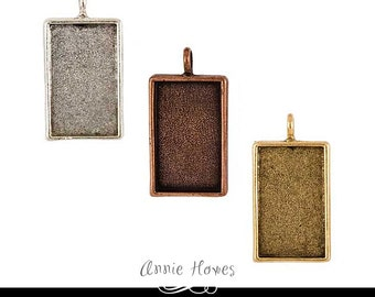 Rectangle Bezel Pendant Setting in Antique Copper Finish. Top with Annie Howes Glamour FX Glass or Resin. 18mm x 30mm inside measurement.