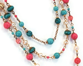 Tiered necklace in turquoise, aqua and coral pink with pearls