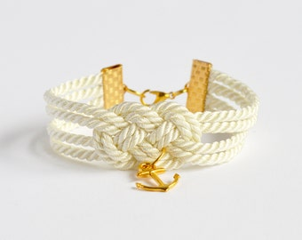Ivory cream double infinity knot nautical rope bracelet with gold anchor charm