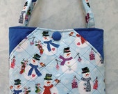Handmade - Simply Pockets Quilted bag, decorated  with cute snowman on a light blue polished cotton, also deep front hip styled pockets