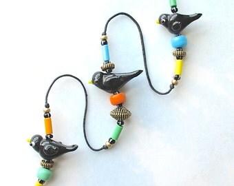 Beaded Windchime. Garden Chime. Lampwork Glass Birds Beads. Black Birds. Crows. Aqua Blue. Yellow. Jadeite Green. Black. Orange. Brass Bell
