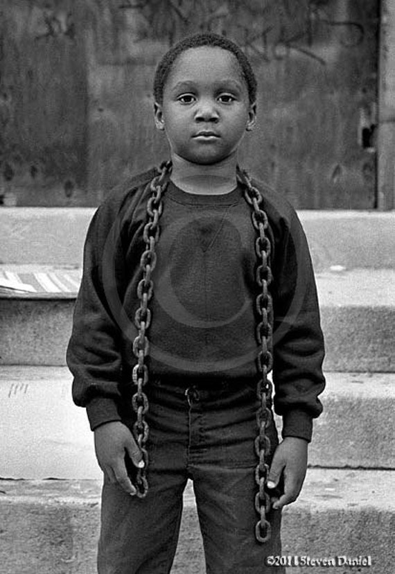 Boy and Chain, Photojournalistic view of Poor Inner City, Poverty, Grafiti Art