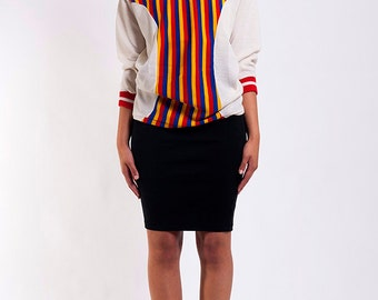 The Vintage VNeck Rainbow Striped Carnival Sweater