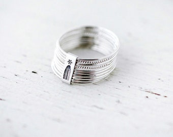 10 twist and turn silver stacking rings