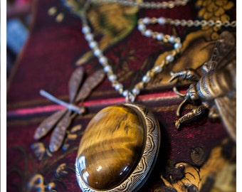 the amulet of mandragora - victorian style brass keepsake locket featuring humongous tiger's eye cabochon