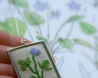 hand embroidered cross stitch pendant