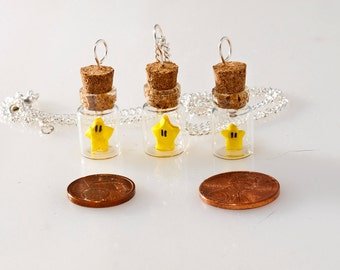Pendant origami Mario Bros star in tiny glass bottle