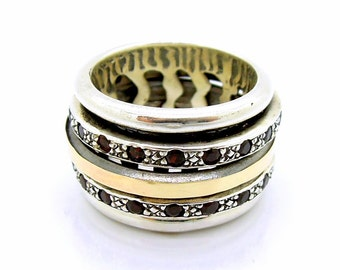 Wide spinner ring with ruby in silver & gold swivel band