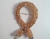 Vintage Hobe gold mesh brooch with rhinestones