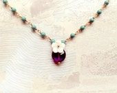 Delicate necklace with amethyst, turquoise pearls and a mother of pearl flower