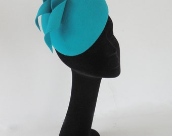 Inspired by the Duchess of Cambridge hat;  auqa blue felt hat on comb
