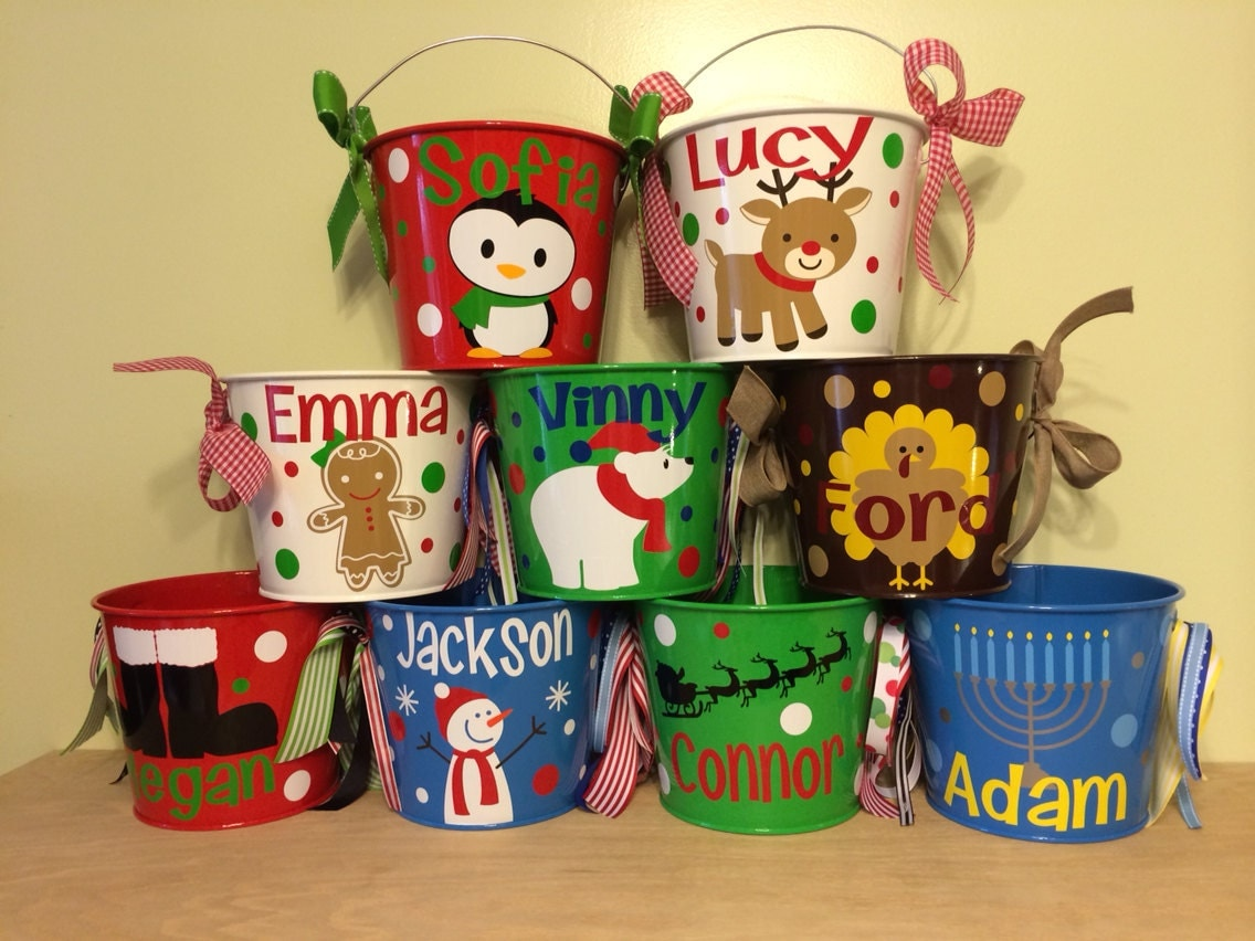 Christmas Buckets found in: Plastic Christmas Buckets with Handles and Lids, Clear Printed Plastic Christmas Buckets, in. Reusable Plastic Popcorn Buckets, 2-ct. Packs, yet still a .