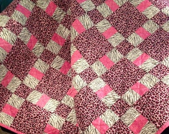 "Animal Prints In Pink, Black and White Are Girly and Bright In This 44.5"" X 44.5"" Quilt"