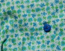 Late 50's-early 60's cotton floral shirt dress with matching belt. One in blue and green floral. One in yellow and pink.